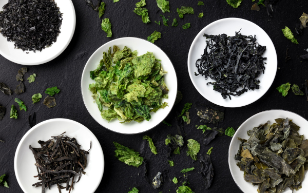 Various dry seaweed, sea vegetables, shot from above on a black background