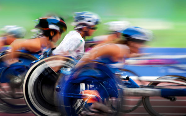 finishing spurt Paralympic wheelchair in motion at the stadium